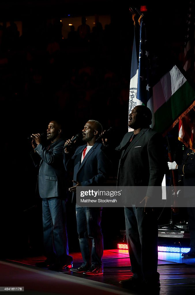 Gospel singers Three Winans Brothers perform the national anthem on opening night of the 2014 US Open at the USTA Billie Jean King National Tennis Center on August 25, 2014 in the Flushing neighborhood of the Queens borough of New York City.