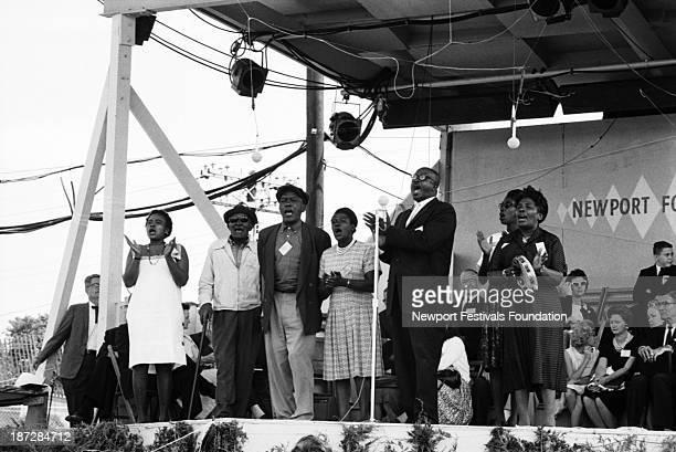 Gospel vocal group the Georgia Sea Island Singers led by gospel singer Bessie Jones perform in July 1964 at the Newport Folk Festival in Newport...