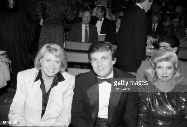 Gossip columnist Liz Smith businessman Donald Trump and his wife Ivana Trump attend 1001 Nights at the Big Apple Circus on November 161987 in New...