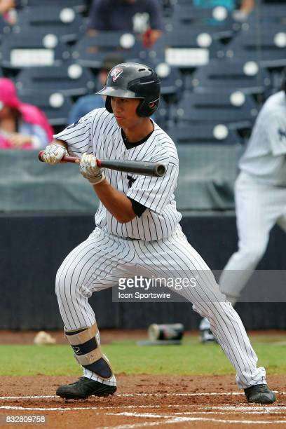 Gosuke Katoh of the Yankees sets up to bunt the pitch during the Florida State League game between the St Lucie Mets and the Tampa Yankees on August...