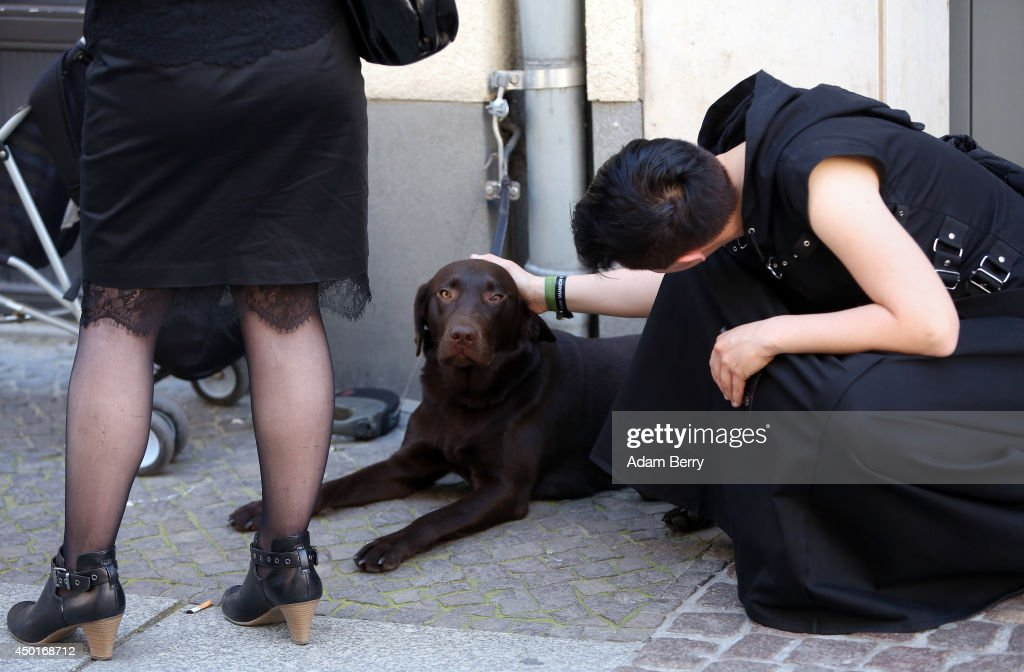 A Goth enthusiast pets a dog during the annual Wave-Gotik-Treffen music festival on June 6, 2014 in Leipzig, Germany. The event began in the 1990s and has since grown into one of the biggest gatherings of the Goth scene in Europe with around 20,000 participants. Many of those attending wear elaborate outfits and makeup for which they require hours of painstaking preparation and that also show a departure from the traditional black of the Goth scene. Punk remains a strong influence in today's Goth style as witnessed in Leipzig, but newer trends, with names like Cybergoth and Steampunk, have emerged that blend bold colours, Victorian fashion elegance and 19th and 20th century factory accessories into a look reminiscent of a mutated Venetian carnival. The five-day festival includes performances by around 200 bands.