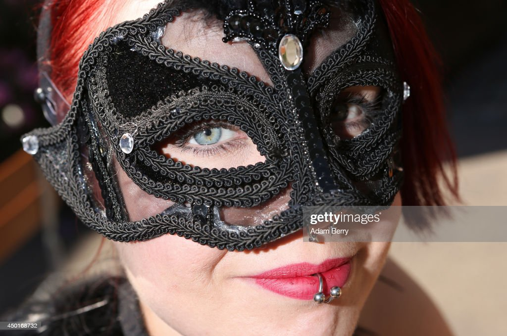 A Goth enthusiast poses during the annual Wave-Gotik-Treffen music festival on June 6, 2014 in Leipzig, Germany. The event began in the 1990s and has since grown into one of the biggest gatherings of the Goth scene in Europe with around 20,000 participants. Many of those attending wear elaborate outfits and makeup for which they require hours of painstaking preparation and that also show a departure from the traditional black of the Goth scene. Punk remains a strong influence in today's Goth style as witnessed in Leipzig, but newer trends, with names like Cybergoth and Steampunk, have emerged that blend bold colours, Victorian fashion elegance and 19th and 20th century factory accessories into a look reminiscent of a mutated Venetian carnival. The five-day festival includes performances by around 200 bands.
