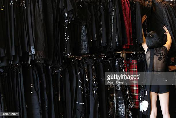 Goth enthusiast shops for Gothic clothing during the annual WaveGotikTreffen music festival on June 7 2014 in Leipzig Germany The event began in the...