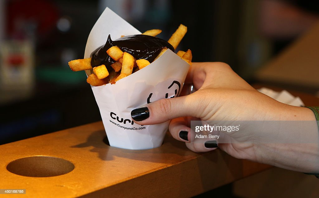 A Goth enthusiast takes an order of French fries with black ketchup during the annual Wave-Gotik-Treffen music festival on June 6, 2014 in Leipzig, Germany. The event began in the 1990s and has since grown into one of the biggest gatherings of the Goth scene in Europe with around 20,000 participants. Many of those attending wear elaborate outfits and makeup for which they require hours of painstaking preparation and that also show a departure from the traditional black of the Goth scene. Punk remains a strong influence in today's Goth style as witnessed in Leipzig, but newer trends, with names like Cybergoth and Steampunk, have emerged that blend bold colours, Victorian fashion elegance and 19th and 20th century factory accessories into a look reminiscent of a mutated Venetian carnival. The five-day festival includes performances by around 200 bands.