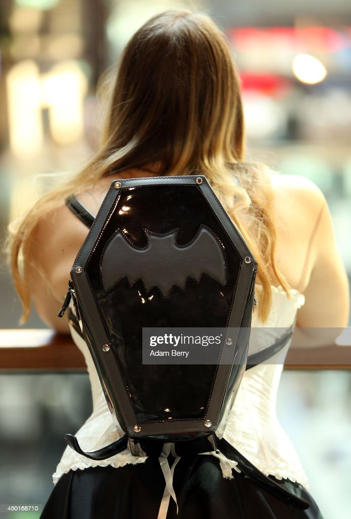 A Goth enthusiast waits on friends while wearing a backpack shaped like a coffin with a bat on it during the annual Wave-Gotik-Treffen music festival on June 6, 2014 in Leipzig, Germany. The event began in the 1990s and has since grown into one of the biggest gatherings of the Goth scene in Europe with around 20,000 participants. Many of those attending wear elaborate outfits and makeup for which they require hours of painstaking preparation and that also show a departure from the traditional black of the Goth scene. Punk remains a strong influence in today's Goth style as witnessed in Leipzig, but newer trends, with names like Cybergoth and Steampunk, have emerged that blend bold colours, Victorian fashion elegance and 19th and 20th century factory accessories into a look reminiscent of a mutated Venetian carnival. The five-day festival includes performances by around 200 bands.