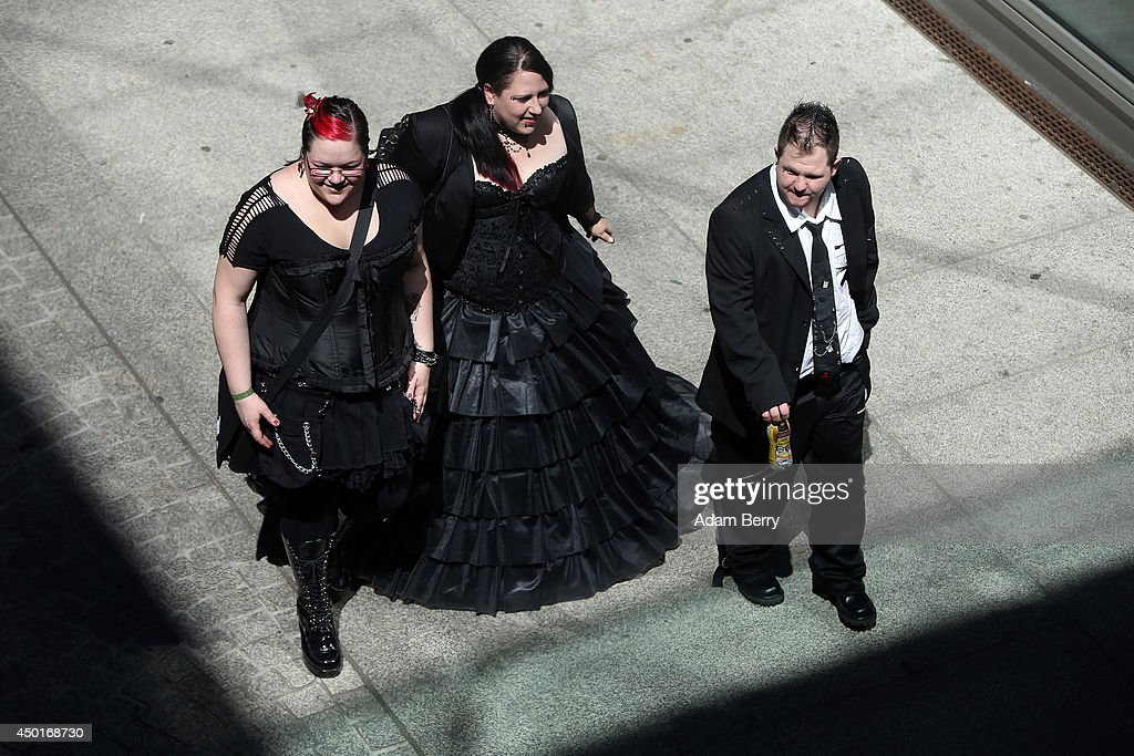 Goth enthusiasts walk through town during the annual Wave-Gotik-Treffen music festival on June 6, 2014 in Leipzig, Germany. The event began in the 1990s and has since grown into one of the biggest gatherings of the Goth scene in Europe with around 20,000 participants. Many of those attending wear elaborate outfits and makeup for which they require hours of painstaking preparation and that also show a departure from the traditional black of the Goth scene. Punk remains a strong influence in today's Goth style as witnessed in Leipzig, but newer trends, with names like Cybergoth and Steampunk, have emerged that blend bold colours, Victorian fashion elegance and 19th and 20th century factory accessories into a look reminiscent of a mutated Venetian carnival. The five-day festival includes performances by around 200 bands.