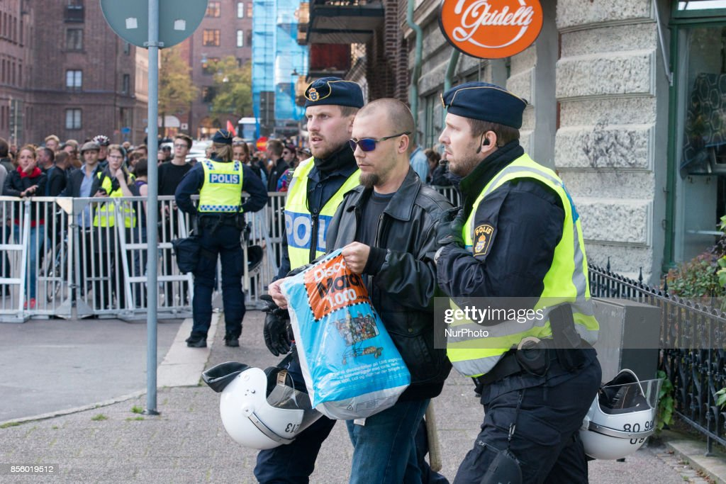 Gothenburg police arrest an antifascist protester as members of the Nordic Resistance Front attempt to march through central Gothenburg on September 30, 2017. The Swedish nazi group Nordic Resistance Front planned to march through central Gothenburg on the day of the Jewish holiday Yom Kippur. The group was expecting 1000 participants, but only about 200-300 came. The march never materialized after Gothenburg Police froze the nazi group's movement after they tried to break their cordon and scuffled with police. Ca 20000 counter protesters circled around the site where the police held the members of the Nordic Resistance Front and scuffles ensued between police and a small number of members of the antifa movement who tried to break through the barricades. About 50 people where arrested, one policeman and a civilian were injured in the scuffles.