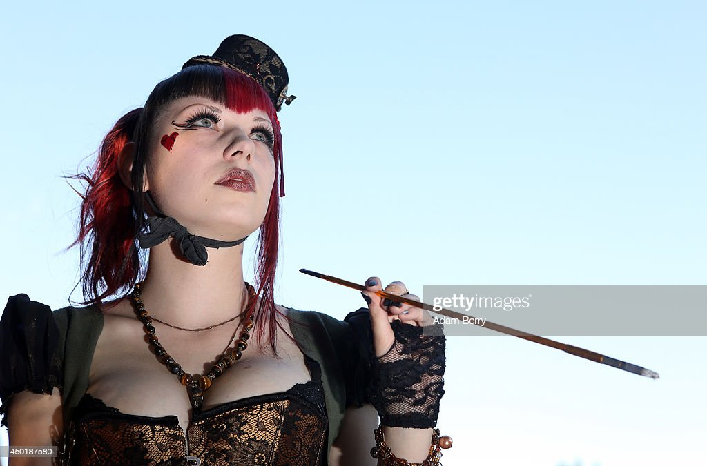 A Gothic enthusiast poses during the annual Wave-Gotik-Treffen music festival on June 6, 2014 in Leipzig, Germany. The event began in the 1990s and has since grown into one of the biggest gatherings of Goth scene followers in Europe with around 20,000 participants. Many of those attending wear elaborate outfits and makeup for which they require hours of painstaking preparation and that also show a departure from the traditional black of the Goth scene. Punk remains a strong influence in today's Goth style as witnessed in Leipzig, but newer trends, with names like Cybergoth and Steampunk, have emerged that blend bold colors, Victorian fashion elegance and 19th and 20th century factory accessories into a look reminiscent of a mutated Venetian carnival. The five-day festival includes performances by around 200 bands.