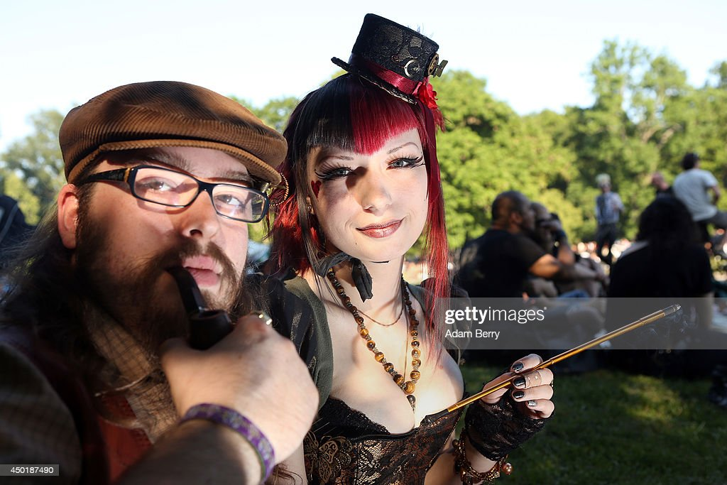 Gothic enthusiasts pose during the annual Wave-Gotik-Treffen music festival on June 6, 2014 in Leipzig, Germany. The event began in the 1990s and has since grown into one of the biggest gatherings of Goth scene followers in Europe with around 20,000 participants. Many of those attending wear elaborate outfits and makeup for which they require hours of painstaking preparation and that also show a departure from the traditional black of the Goth scene. Punk remains a strong influence in today's Goth style as witnessed in Leipzig, but newer trends, with names like Cybergoth and Steampunk, have emerged that blend bold colors, Victorian fashion elegance and 19th and 20th century factory accessories into a look reminiscent of a mutated Venetian carnival. The five-day festival includes performances by around 200 bands.