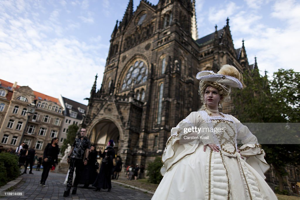 Gothic enthusiasts stand in front of a church after a classic concert during the annual Wave Gotik music festival on June 11, 2011 in Leipzig, Germany. The festival began in the 1990s and has since grown into one of the biggest gatherings of Goth scene followers in Europe with around 20,000 participants. Many of those attending wear elaborate outfits and make-up for which they require hours of painstaking preparation and that also show a departure from the traditional black of the Goth scene. Punk remains a strong influence in today«s Goth style as witnessed in Leipzig, but newer trends, with names like Cybergoth and Steampunk, have emerged that blend bold colors, Victorian fashion elegance and 19th and 20th century factory accessories into a look reminiscent of a mutated Venetian carnival. The five-day festival includes performances by around 200 bands.
