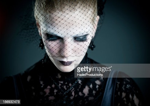 Gothic fashion model with a black lace on her eyes : Stock Photo