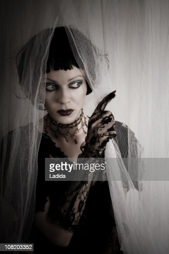 Gothic Girl Wearing Black Lace Gloves