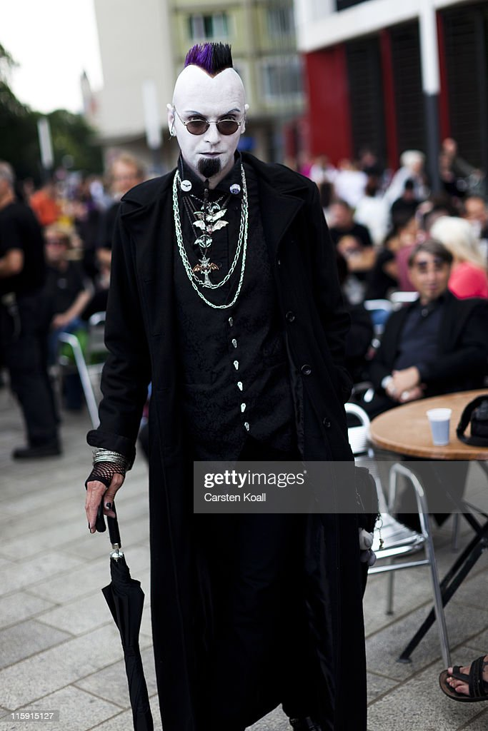 A Gothic rock music enthusiast walks on the street during the annual Wave Gotik music festival on June 11, 2011 in Leipzig, Germany. The festival began in the 1990s and has since grown into one of the biggest gatherings of Goth scene followers in Europe with around 20,000 participants. Many of those attending wear elaborate outfits and make-up for which they require hours of painstaking preparation and that also show a departure from the traditional black of the Goth scene. Punk remains a strong influence in todays Goth style as witnessed in Leipzig, but newer trends, with names like Cybergoth and Steampunk, have emerged that blend bold colors, Victorian fashion elegance and 19th and 20th century factory accessories into a look reminiscent of a mutated Venetian carnival. The five-day festival includes performances by around 200 bands.