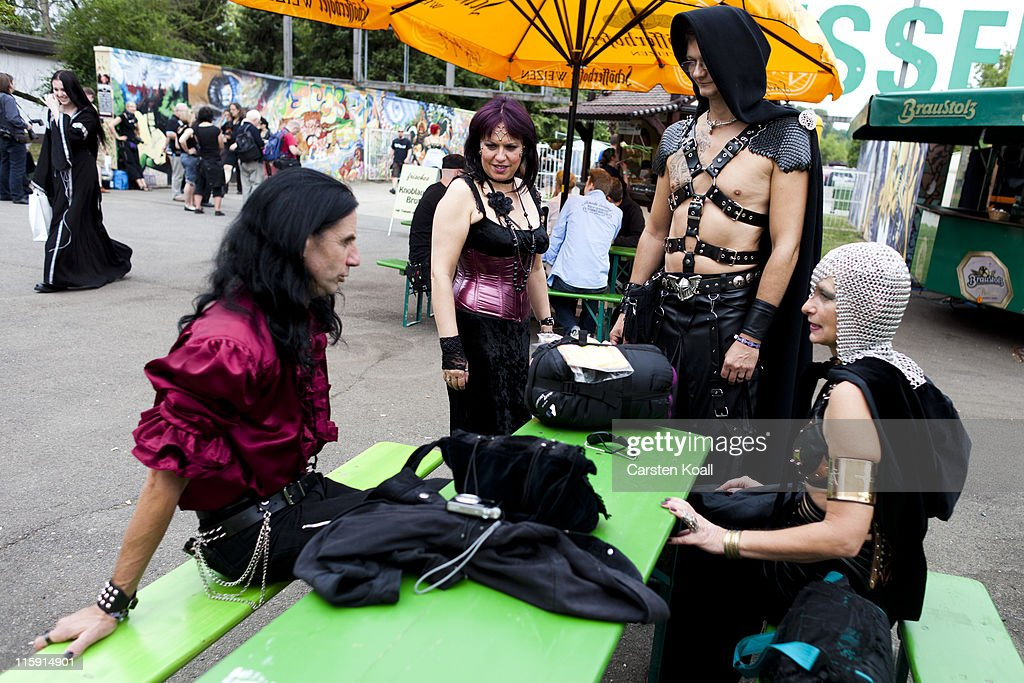 Gothic rock music enthusiasts make a break during the annual Wave Gotik music festival on June 11, 2011 in Leipzig, Germany. The festival began in the 1990s and has since grown into one of the biggest gatherings of Goth scene followers in Europe with around 20,000 participants. Many of those attending wear elaborate outfits and make-up for which they require hours of painstaking preparation and that also show a departure from the traditional black of the Goth scene. Punk remains a strong influence in todays Goth style as witnessed in Leipzig, but newer trends, with names like Cybergoth and Steampunk, have emerged that blend bold colors, Victorian fashion elegance and 19th and 20th century factory accessories into a look reminiscent of a mutated Venetian carnival. The five-day festival includes performances by around 200 bands.