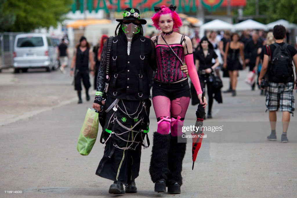 Gothic rock music enthusiasts walk the streets between venues during the annual Wave Gotik music festival on June 11, 2011 in Leipzig, Germany. The festival began in the 1990s and has since grown into one of the biggest gatherings of Goth scene followers in Europe with around 20,000 participants. Many of those attending wear elaborate outfits and make-up for which they require hours of painstaking preparation and that also show a departure from the traditional black of the Goth scene. Punk remains a strong influence in todayÕs Goth style as witnessed in Leipzig, but newer trends, with names like Cybergoth and Steampunk, have emerged that blend bold colors, Victorian fashion elegance and 19th and 20th century factory accessories into a look reminiscent of a mutated Venetian carnival. The five-day festival includes performances by around 200 bands.