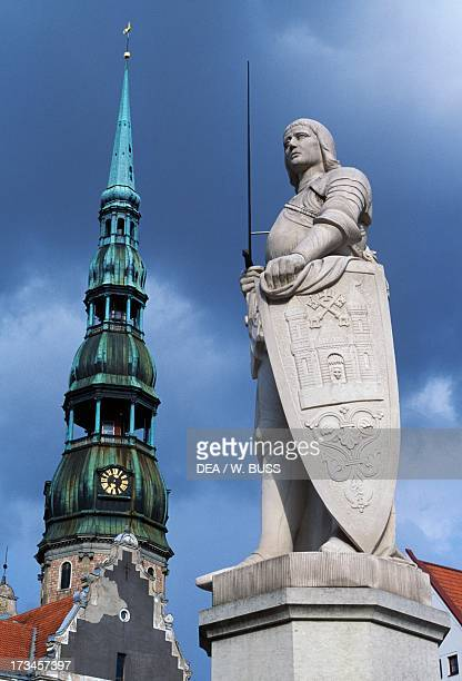 Gothic spire of the Church of St Peter and statue of Roland Riga Latvia