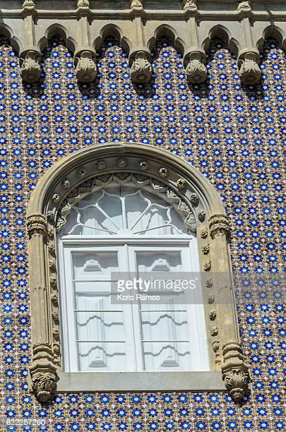 Gothic style window in tile wall