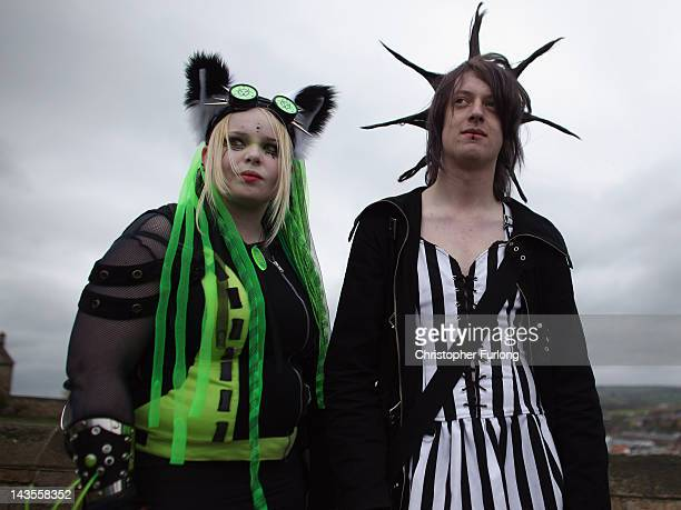 Goths stand near the abbey during the Whitby Goth Weekend on April 28 2012 in Whitby England Whitby Gothic Weekend which started in 1994 to celebrate...