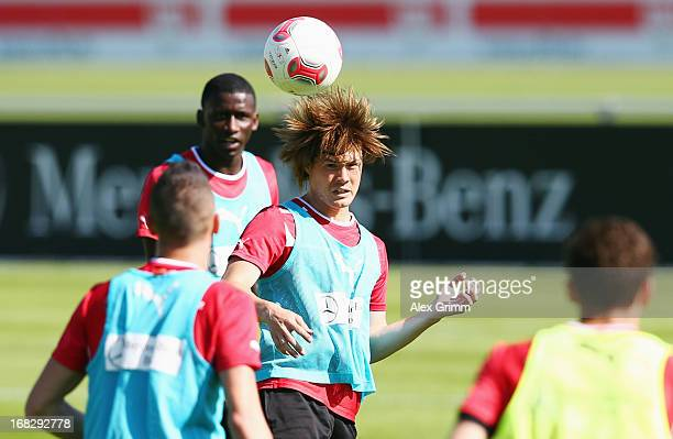 Gotoku Sakai jumps for a header during a VfB Stuttgart training session at the club's premises on May 8 2013 in Stuttgart Germany