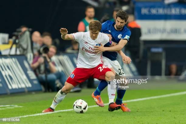 Gotoku Sakai of Hamburg and Coke of Schalke battle for the ball during to the Bundesliga match between FC Schalke 04 and Hamburger SV at VeltinsArena...