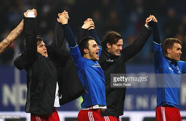 Gotoku Sakai of Hamburg celebrates with teamates their win at the end of the Bundesliga match between Hamburger SV and FC Augsburg at...