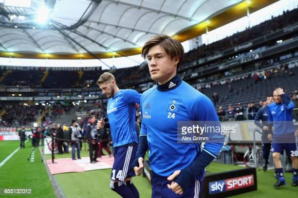 Gotoku Sakai of Hamburg enters the pitch to warm up for the Bundesliga match between Eintracht Frankfurt and Hamburger SV at CommerzbankArena on...