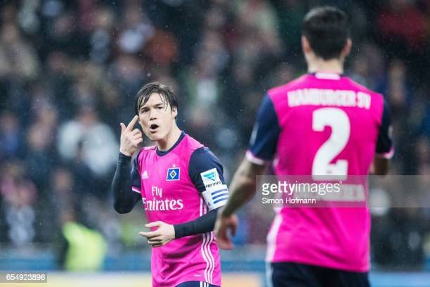 Gotoku Sakai of Hamburg gives directions during the Bundesliga match between Eintracht Frankfurt and Hamburger SV at CommerzbankArena on March 18...