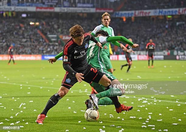 Gotoku Sakai of Hamburg is challenged by Santiago García of Bremen during the Bundesliga match between Werder Bremen and Hamburger SV at Weserstadion...
