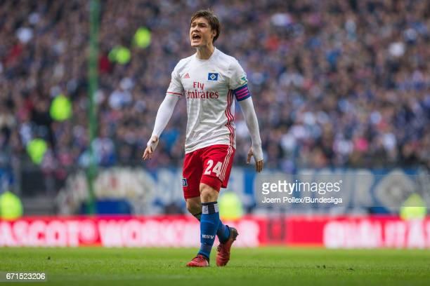 Gotoku Sakai of Hamburg reacts during the Bundesliga match between Hamburger SV and SV Darmstadt 98 at Volksparkstadion on April 22 2017 in Hamburg...