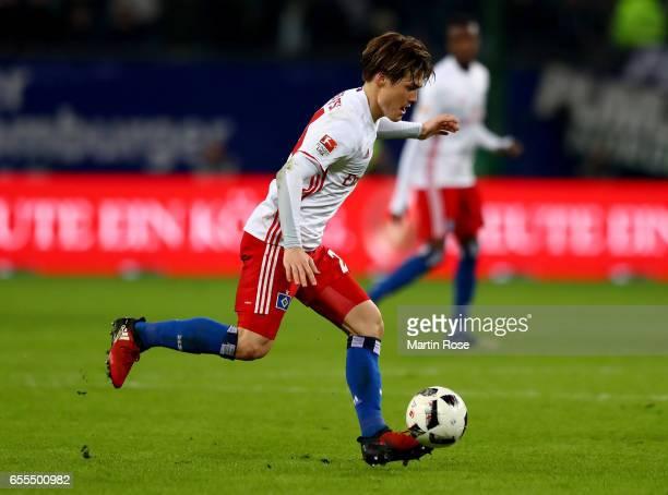 Gotoku Sakai of Hamburg runs with the ball during the Bundesliga match between Hamburger SV and Borussia Moenchengladbach at Volksparkstadion on...