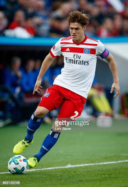 Gotoku Sakai of Hamburg runs with the ball during the Bundesliga match between Bayer 04 Leverkusen and Hamburger SV at BayArena on September 24 2017...