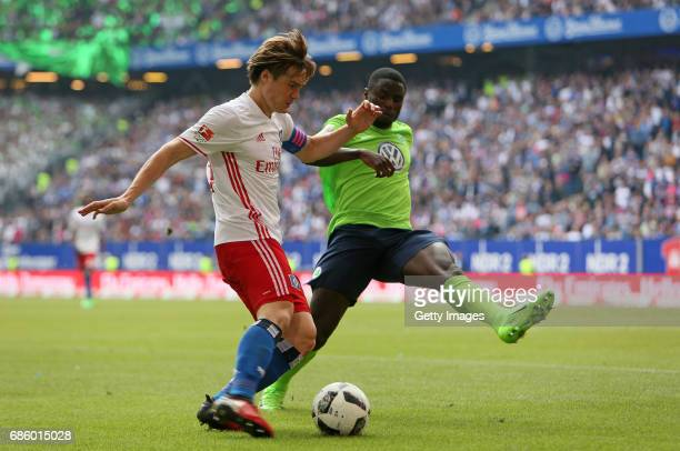 Gotoku Sakai of HSV fights for the ball with PaulGeorges Ntep of Wolfsburg during the Bundesliga match between Hamburger SV and VfL Wolfsburg at...