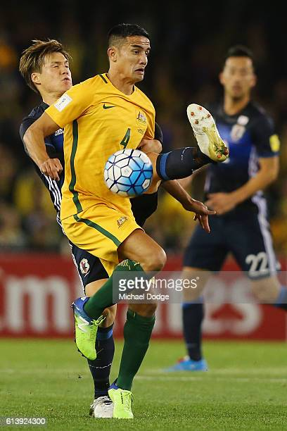 Gotoku Sakai of Japan and Tim Cahill of the Socceroos compete for the ball during the 2018 FIFA World Cup Qualifier match between the Australian...
