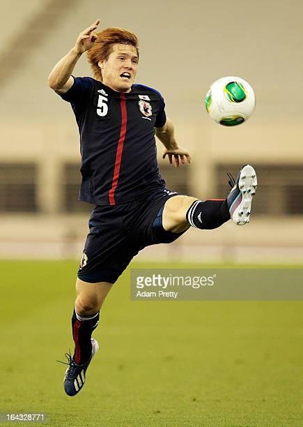 Gotoku Sakai of Japan brongs down the ball during the international friendly match between Japan and Canada at Khalifa International Stadium on March...