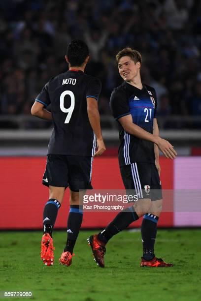 Gotoku Sakai of Japan celebrates his side's third goal with his team mate Yoshinori Muto during the international friendly match between Japan and...