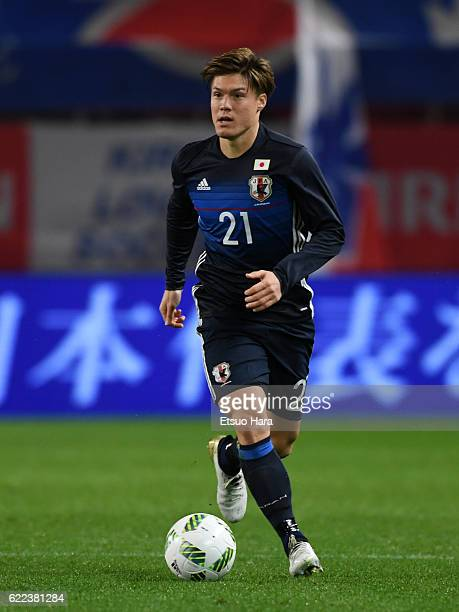 Gotoku Sakai of Japan in action during the international friendly match between Japan and Oman at Kashima Soccer Stadium on November 11 2016 in...