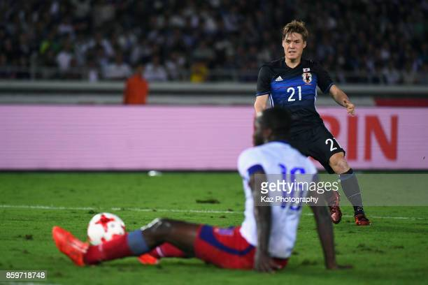 Gotoku Sakai of Japan shoots resulting in Japan's third goal scored by Shinji Kagawa during the international friendly match between Japan and Haiti...