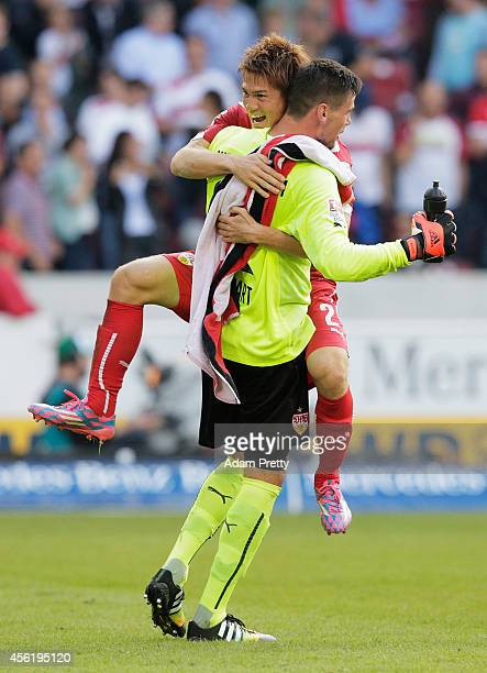 Gotoku Sakai of Stuttgart celebrates victory with Thorsten Kirschbaum after the Bundesliga match between VfB Stuttgart and Hannover 96 at...