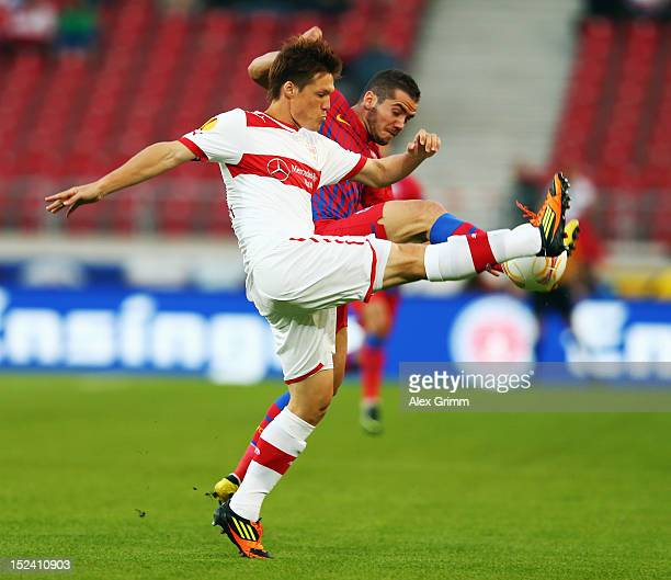 Gotoku Sakai of Stuttgart is challenged by Alexandru Chipciu of Bucuresti during the UEFA Europa League group E match between VfB Stuttgart and FC...