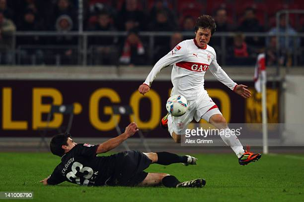 Gotoku Sakai of Stuttgart is challenged by Florian Dick of Kaiserslautern during the Bundesliga match between VfB Stuttgart and 1 FC Kaiserslautern...
