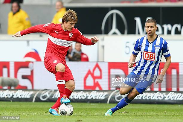 Gotoku Sakai of Stuttgart is challenged by Marcel Ndjeng of Berlin during the Bundesliga match between VfB Stuttgart and Hertha BSC Berlin at...