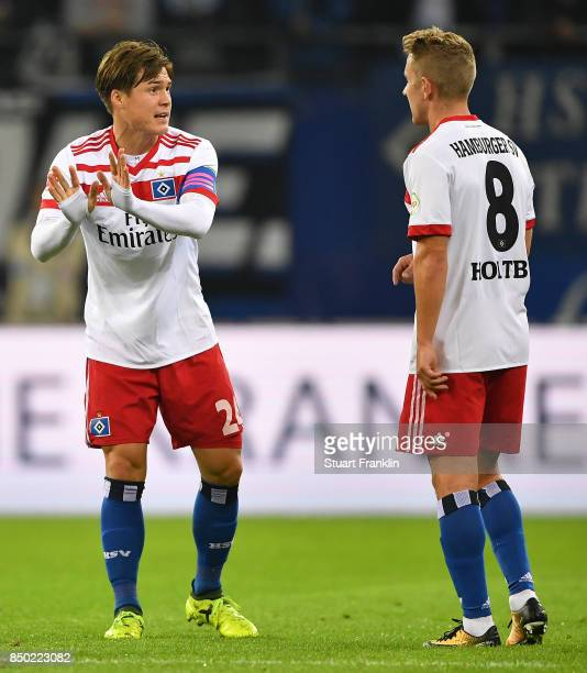 Gotoku Sakaiof Hamburg talks with Lewis Holtby of Hamburg during the Bundesliga match between Hamburger SV and Borussia Dortmund at Volksparkstadion...