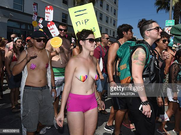 GoTopless Day demonstrators march during their annual protest for women's rights in Venice Beach California on August 23 2015 The protest is held to...