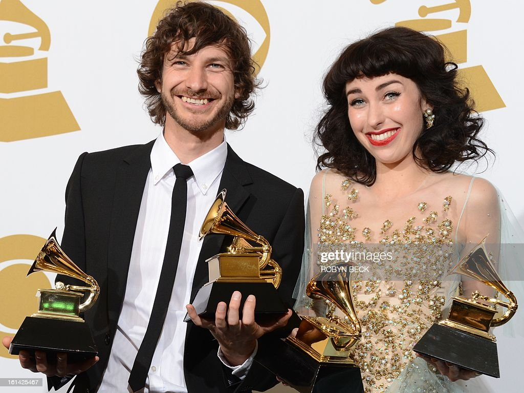Gotye and Kimbra pose in the press room with their trophies at the Staples Center during the 55th Grammy Awards in Los Angeles, California, February 10, 2013. AFP PHOTO Robyn BECK