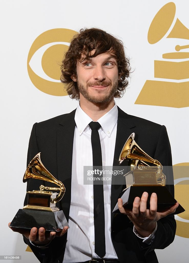 Gotye poses in the press room with his trophies at the Staples Center during the 55th Grammy Awards in Los Angeles, California, February 10, 2013. AFP PHOTO Robyn BECK