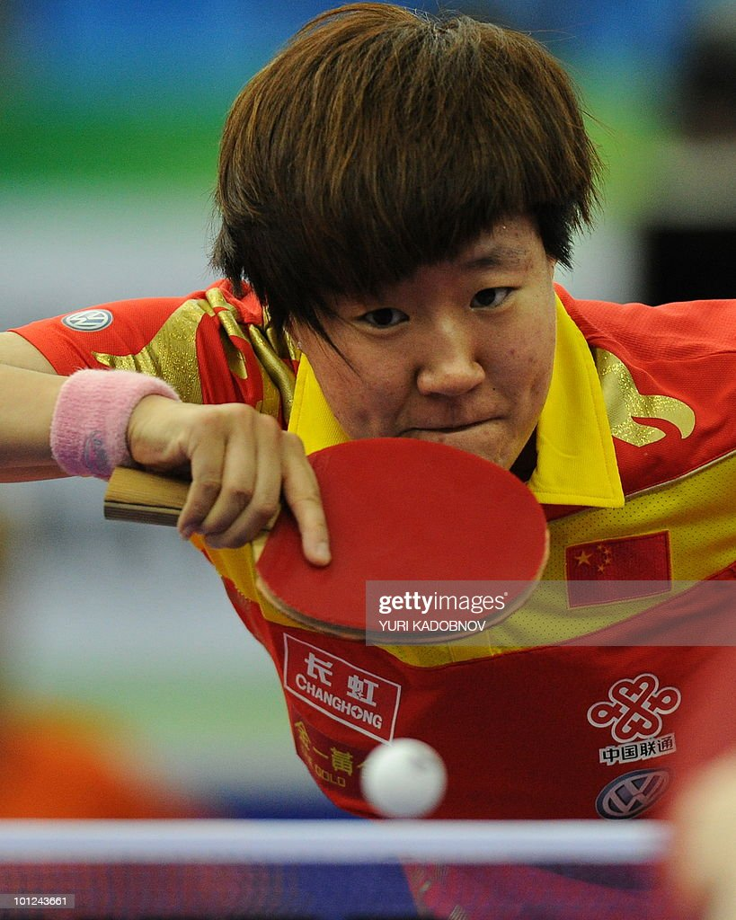Gou Yan of China returnes a serve to Carla Nouwen of Netherlands during the women's quarter final at the 2010 World Team Table Tennis Championships in Moscow on May 28, 2010.