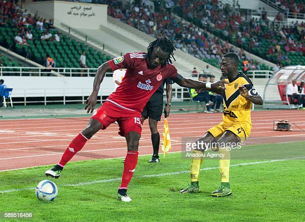 Goua Mahan Marc of ASEC and Mourtada Fall of Wydad Casablanca vie for the ball during the Group A match of CAF Champions League between Wydad...