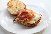 Gouda,prosciutto and egg breakfast sandwich