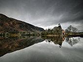 Lake and the oratory at Gougane Barra, Ireland.