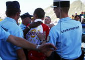 Italys Cristian Moreni is arrested by French gendarmes as he leaves the antidoping car control after the 16th stage of the 94th Tour de France...
